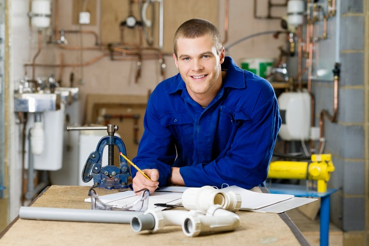 Plumber Standing at Workbench